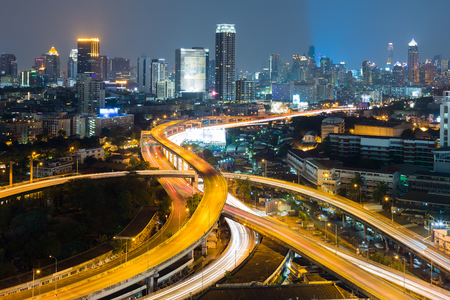 interchanged: Aerial view interchanged road with city downtown background night view Stock Photo