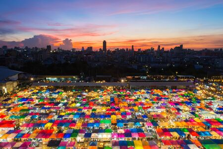 fleamarket: Roof top over Bangkok flea market at night with city downtown background
