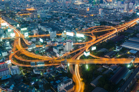 interchanged: Highest Aerial view of Bangkok Highway interchanged at Dusk in Thailand Stock Photo