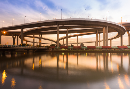 interchanged: Interchanged over highway curve with water reflection during sunset