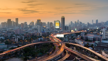 interchanged: Sunset over Bangkok city downtown background and interchanged expressway, Thailand