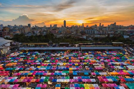 fleamarket: Sunset sky over weekend night market, multiple colour background