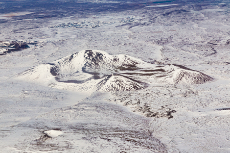 sunshines: Aerial view, Iceland mountain with snow coved, during winter season Stock Photo