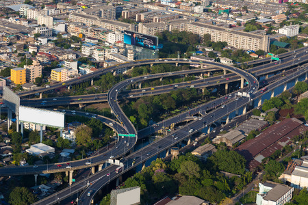 interchanged: Aerial view highway interchanged and city downtown background Editorial