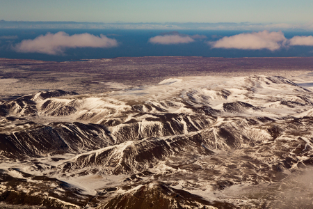 sunshines: Beautiful aerial view snow covered mountain, winter landscape Iceland Stock Photo