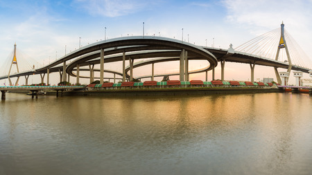 full suspended: Panorama Twin Suspension bridge connect to highway interchange in Bangkok Thailand during sunset Stock Photo