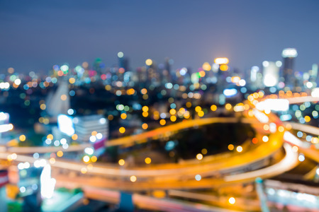 interchanged: Aerial view, abstract blurred bokeh lights, Highway interchanged and city downtown background Stock Photo