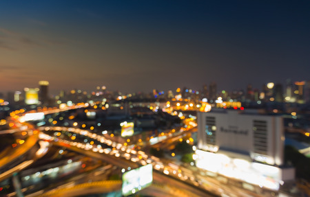 interchanged: Aerial view night view, blurred bokeh lights, city downtown and highway interchanged