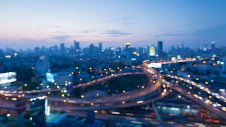 interchanged: Blurred bokeh lights, Highway interchanged and city downtown background after sunset