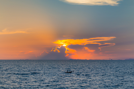 seacoast: Dramatic sun lights background over seacoast during sunset Stock Photo