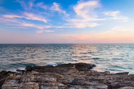 seacoast: Rocky beach over skyline seacoast with beautiful sky background