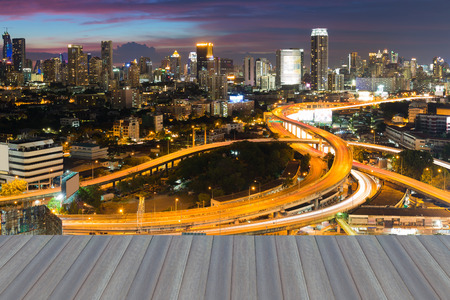 interchanged: Opening wooden floor, City highway interchanged and downtown background night view