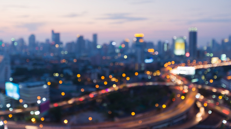 interchanged: Blurred interchanged road and city downtown background after sunset, abstract background Stock Photo