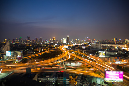 interchanged: Abstract blurred bokeh lights highway interchanged and city downtown background, night view Stock Photo