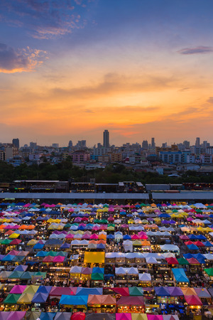 Dramatic sky during sunset over city night market Stock Photo
