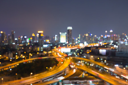 interchanged: Abstract blurred bokeh lights, city downtown background and highway interchanged, night view