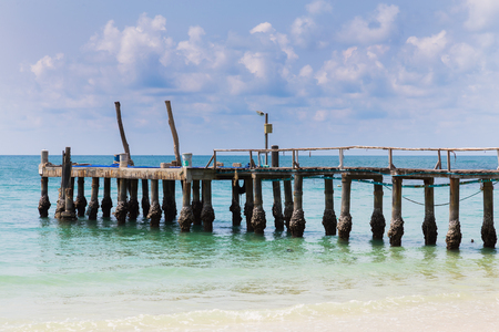 fishing pier: Fishing pier over natural beach skyline, natural landscape skyline background