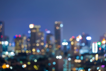 dallas: Blurred light city and office building night view, abstract background