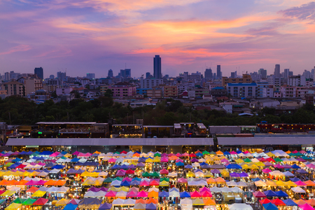 fleamarket: Colourful aerial view flea market with city downtown and dramatic sky background