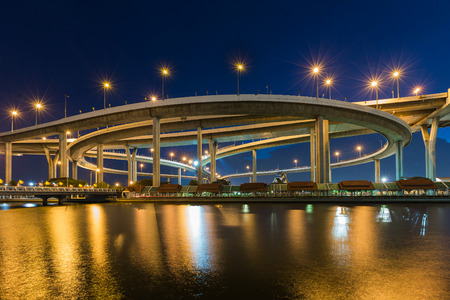 interchanged: Twilight over Highway interchanged river front with reflection at night Stock Photo