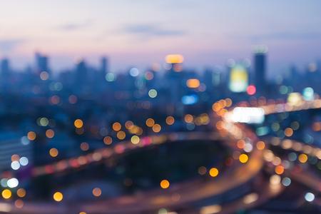 interchanged: Blurred bokeh lights, interchanged road with CBD background Stock Photo