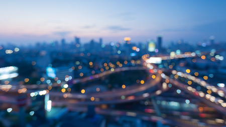 interchanged: Blurred bokeh lights city interchanged and city downtown background night view