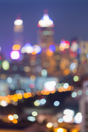 dallas: Nights blurred bokeh lights office building central business downtown, multiple colours abstract background Stock Photo
