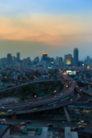 interchanged: Abstract blurred lights, city downtown background and highway interchanged after sunset
