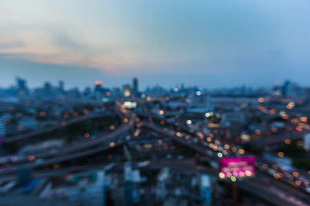 interchanged: Blurred lights, city downtown background and highway interchanged after sunset