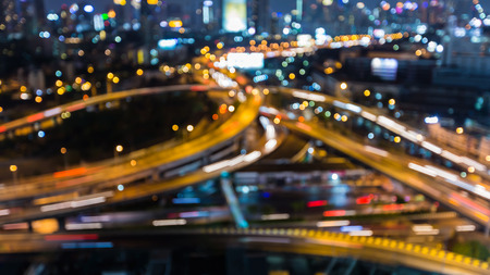 interchanged: Blurred bokeh lights city highway interchanged night view, abstract background