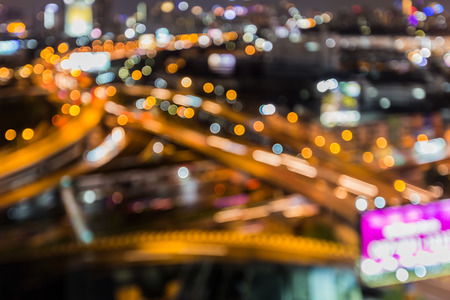 highway night: Blurred bokeh lights aerial view intersection highway night view, abstract background