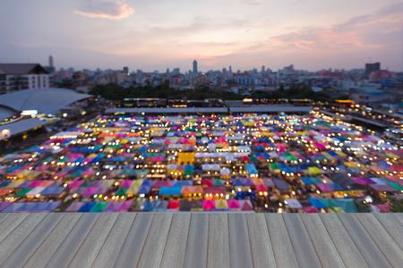 fleamarket: Opening wooden floor, Night blurred bokeh background, colourful night market roof top