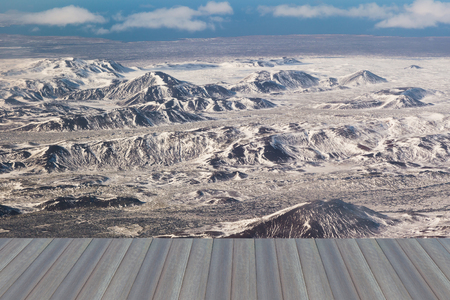 sunshines: Opening wooden floor, Aerial view snow covered mountains, Iceland natural landscape Stock Photo