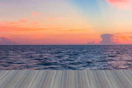 Opening wooden floor, Sunset over seacoast skyline, natural landscape background