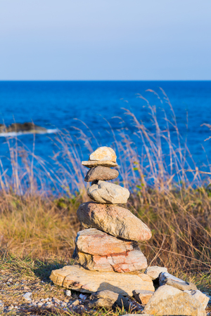 stack stone: Natural stack stone with blue sea background, natural landscape