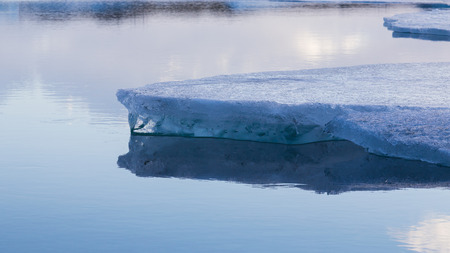 breaking in: Ice breaking in the lake close up, natural winter landscape background