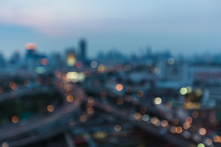 interchanged: Abstract blurred lights night view, city and highway interchanged, at twilight