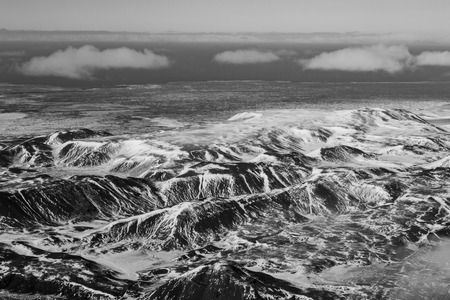 sunshines: Black and White, Aerial view snow covered mountains, Iceland natural landscape Stock Photo