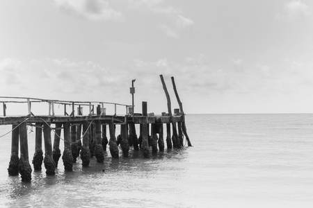 hatteras: Black and White, Fishing jetty over the beach, natural landscape background Stock Photo