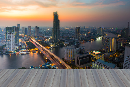 plano: Opening wooden floor, After sunset over Bangkok main river curved, Thailand