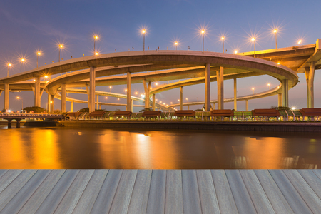 Opening wooden floor, Twilight over Highway interchanged river front with reflection at night