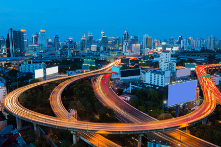Bangkok Downtown City background and highway interchanged with blue sky Stock Photo