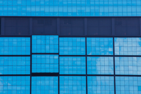 glass panel: Office building structure built by blue glass panel