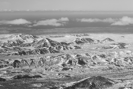 sunshines: Black and White, Aerial view of showy mountains during winter, Iceland