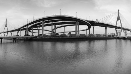highway interchange: Black and White, Panorama Twin suspension bridge connect to highway interchange river front, Bangkok Thailand
