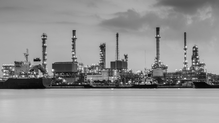 riverfront: Black and White, Petroleum refinery riverfront during sunrise Editorial