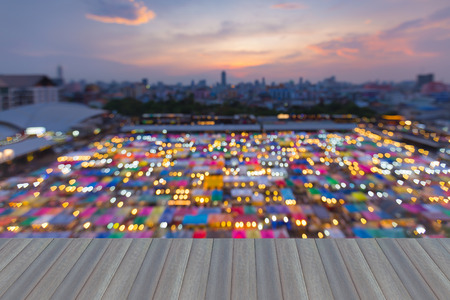 Opening wooden floor, Blur light night view of Flea market aerial view with beautiful sky after sunset