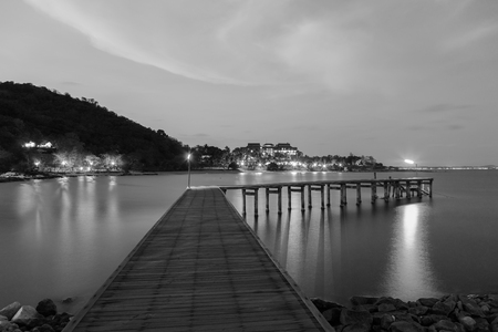 hatteras: Black and White, Wooden bridge walkway leading to the sea night view, with mountain background