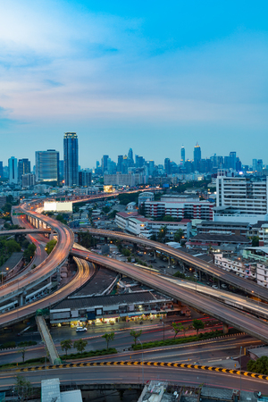 Long exposure, highway interchanged and city downtown background at twilight Stock Photo