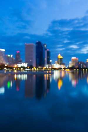 Twilight city downtown water front blurred bokeh lights Stock Photo